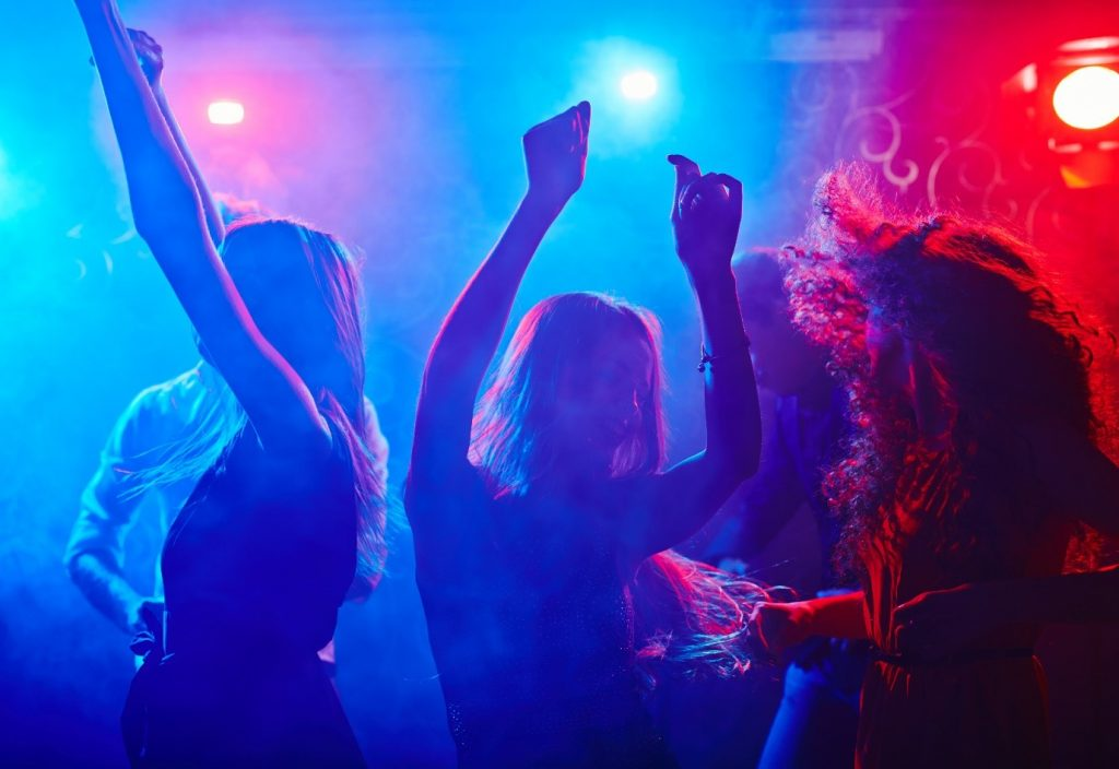 Party atmosphere with DJ playing